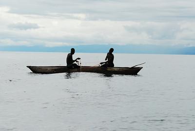 Fishermen in dugout canoe, Lake Malawi.