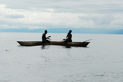 Fishermen in dugout canoe, Lake Malawi.