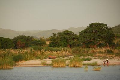 Women and boat, Cobue village, Mozambique, from MV Ilala, Lake Malawi.