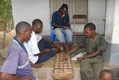 The boys, wasting the afternoon away in Likoma village, Likoma Island, Malawi.