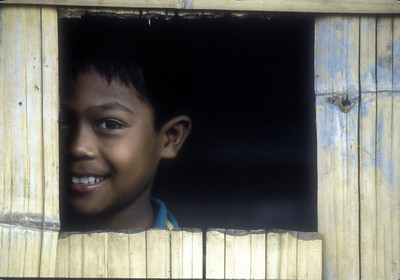 Boy in stilt village, Malaysian Borneo.