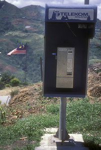 Public phone & national flag, rural Malaysia.