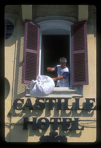 Tossing laundry to the street below at the Castille Hotel, Valetta, Malta.