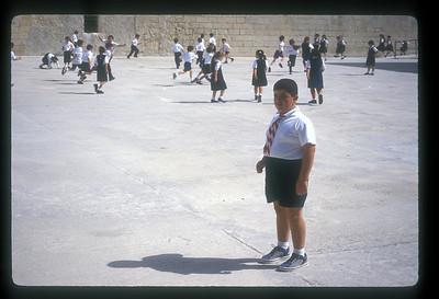 Children in school playground, Valetta, Malta.