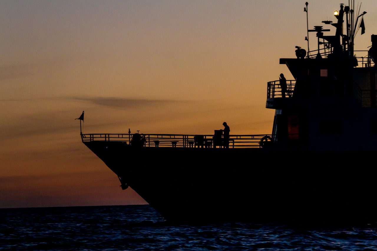Silhouette of ship sailing in sea at dusk - Mexico