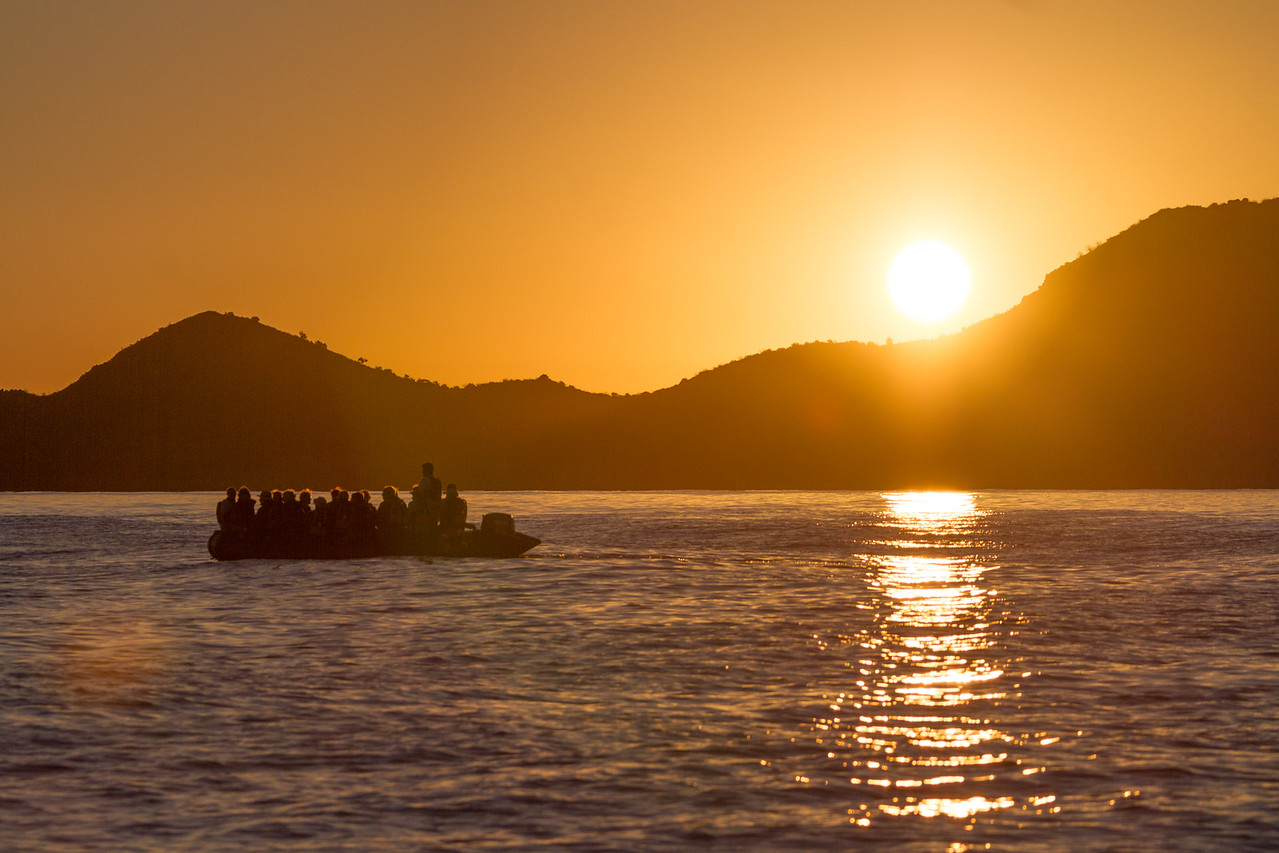 Tourist travelling on boat during sunrise - Mexico