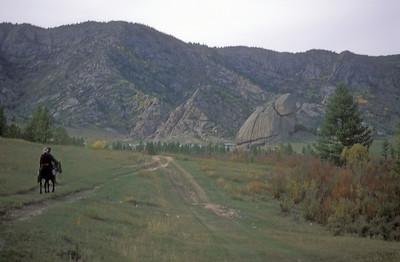 Turtle rock (distance), rural Mongolia.
