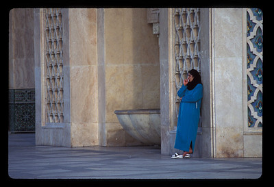 Woman outside Hassan II mosque, Casablanca, Morocco.