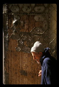Man at door to courtyard of mosque, Fez, Morocco.