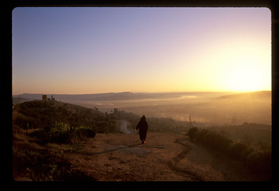 Man in jalaba, dawn outside Fez, Morocco.
