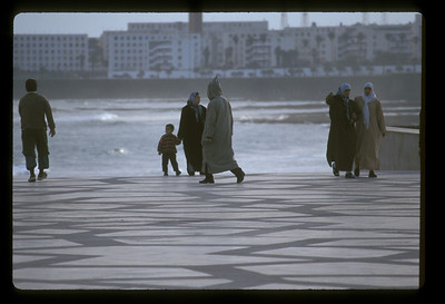 Tidal pool and people on plaza outside Hassan II mosque, Casablanca, Morocco.