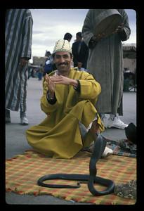 Snake charmer at Plaza Djemma el Fna, Marrakech, Morocco.