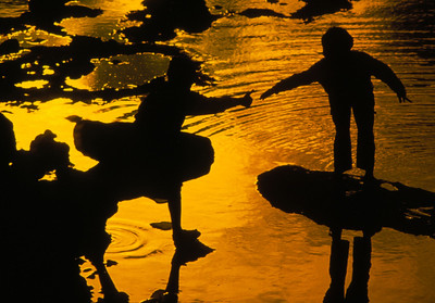 Children playing in tidal pool, Casablanca, Morocco.