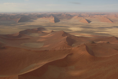 Sand dunes on the march, Namibia.