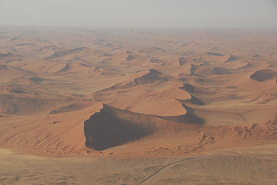 Sand dunes in Namib-Naukluft Park, Namibia. Park road in foreground.