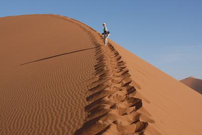 Dune climbing, Sossusvlei, Namibia.