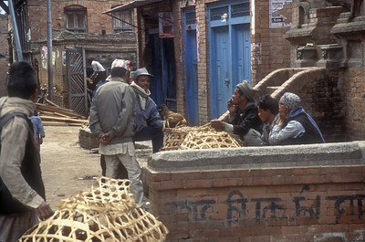 Men buy and sell chickens, Bhaktapur, Nepal.