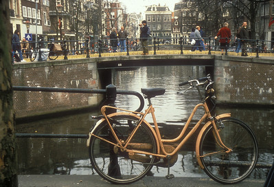 Bicycle and canal bridge, Amsterdam, the Netherlands.