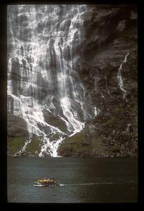 Waterfall in Norwegian fjord.
