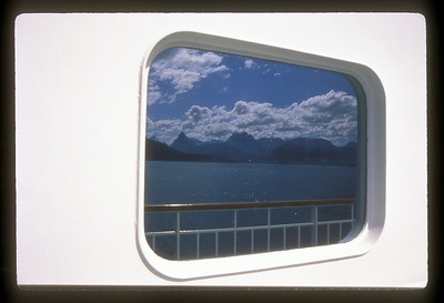 Window on cruise ship in Geiranger fjord, Norway.
