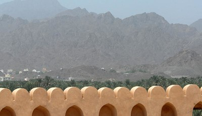 View over the ramparts of the Nizwa fort, Nizwa, Oman.