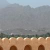 View over the ramparts of the Nizwa fort, Nizwa, Oman.