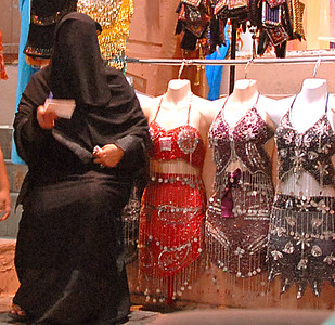 Two approaches to dress. Muttrah Souk, Muttrah, Oman.