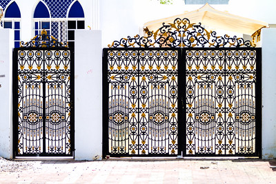 A decorated entrance gate for a property in Oman