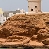 View of lighthouse on cliff - Oman
