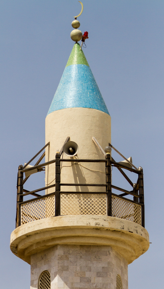 Minaret with loudspeakers against sky - Oman