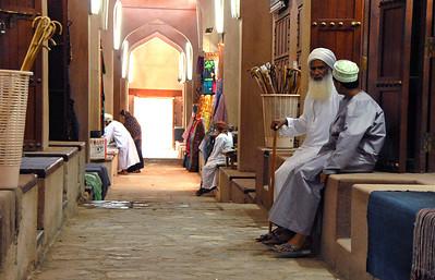 Men at souk, Nizwa, Oman.