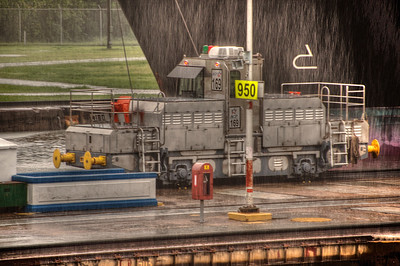 HDR: Tow train and ship's hull, Panama Canal, in the rain.