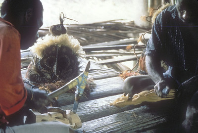 Workers carving masks, Sepik River, Papua New Guinea.