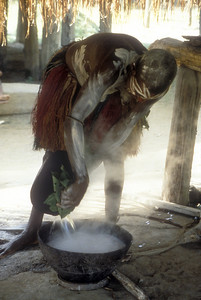 Cooking a sago paste in a village along the Sepik River, Papua New Guinea.