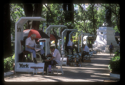 Shoeshine kiosks in city park, Asuncion, Paraguay.
