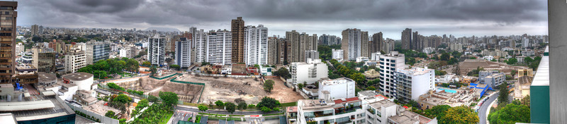 Small panorama of Lima, Peru from the 18th floor. That's the sea out there, but it's a little overcast just now. Four HDRs combined, each bracketed 3x. Click it to make it much, much bigger.
