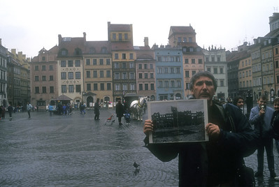 The rebuilt Old City and photo of prior war damage, Warsaw, Poland.
