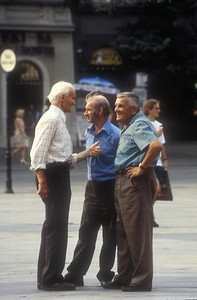 Three retirees gossip, Krakow, Poland.