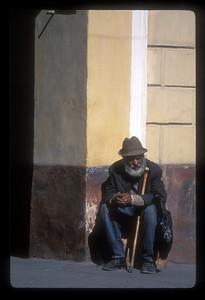 Man with hat and cane, Brasov, Transylvania, Romania.