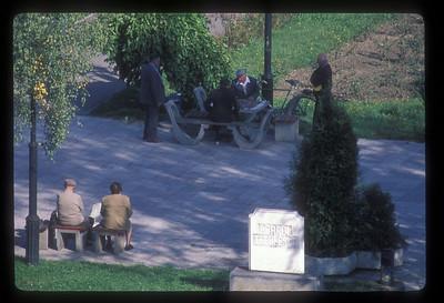 Men play chess on the central square, Brasov, Transylvania, Romania.