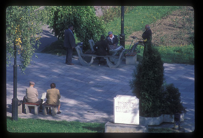 Men play chess on the central square, Brasov, Transylvania, Romania.