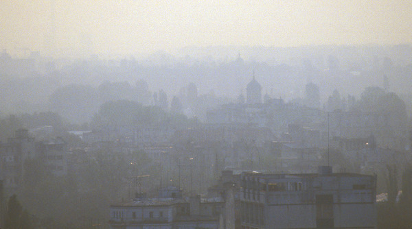 Pollution and the downtown Bucharest, Romania, skyline.