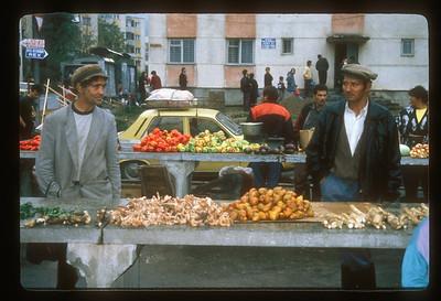 Roma produce salesmen at Sighisoara, Transylvania, Romania, farmer's market.