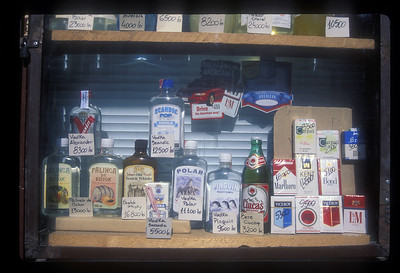Cigarettes and alcohol in a shop window, Romania.