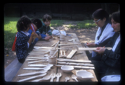 Kids learn traditional crafts at the open air Village Museum, Herastrau Park, Bucharest, Romania.