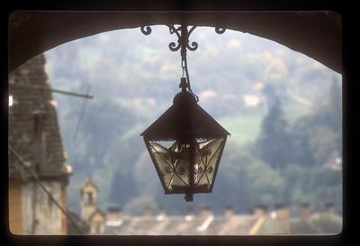 Lamp and arch, Sighisoara, Transylvania, Romania.