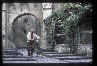 Man and bicycle, Sighisoara, Transylvania, Romania.