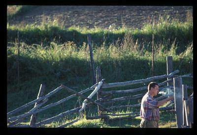 Farmer takes a smoke break, Listvyanka, Siberia, Russia.
