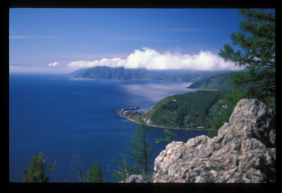 Trans-Siberian railroad (middle ground) on the shore of Lake Baikal, Siberia, Russia.