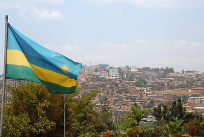 Skyline and national flag, Kigali, capital of Rwanda.